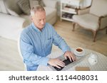 serious mature man with laptop... | Shutterstock . vector #1114408031