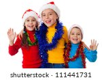 Three happy children in Santa hats with greeting sign, isolated on white - stock photo