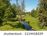 stone bridge and trees in ... | Shutterstock . vector #1114418339