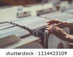 women's hands browsing vinyl... | Shutterstock . vector #1114423109