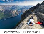 the norwegian lysefjord  a... | Shutterstock . vector #1114440041