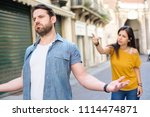 young couple arguing in the... | Shutterstock . vector #1114474871