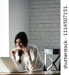 smiling girl working with... | Shutterstock . vector #1114507151