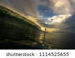 slim girl surfing in a huge...   Shutterstock . vector #1114525655