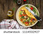 omelet with tomatoes  zucchini... | Shutterstock . vector #1114532927