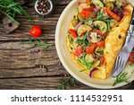 omelet with tomatoes  zucchini... | Shutterstock . vector #1114532951