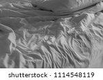 bed linen crumpled | Shutterstock . vector #1114548119