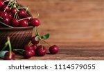 sweet cherry on wooden... | Shutterstock . vector #1114579055