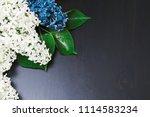 a bouquet of lilac lies on a...   Shutterstock . vector #1114583234