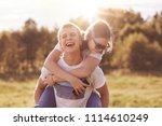 funny happy boy gives piggyback ... | Shutterstock . vector #1114610249