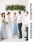 bride and groom holding hands... | Shutterstock . vector #1114620794