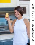 woman withdrawing money from... | Shutterstock . vector #1114641005