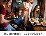 smiling waiter bringing ordered ... | Shutterstock . vector #1114643867
