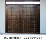 Small photo of Detail of multiple Bank Deposit Boxes on a wall each of them numbered with dedicated number
