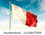 malta flag on the blue sky with ... | Shutterstock . vector #1114647944