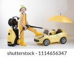 happy child in yellow overalls... | Shutterstock . vector #1114656347