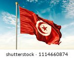 tunisia flag on the blue sky... | Shutterstock . vector #1114660874