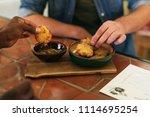 closeup of two men sitting...   Shutterstock . vector #1114695254