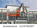 Small photo of Vaughan, Ontario, Canada- June 10, 2018: Sign of SmartCentres Real Estate Investment Trust at headquarters, one of Canada's largest real estate investment trusts, based in Vaughan, Ontario.