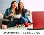 happy girl friends watching tv... | Shutterstock . vector #1114722707