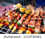 bbq and shrimp on charcoal... | Shutterstock . vector #1114730381