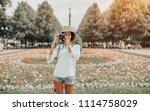 serious black tourist hipster... | Shutterstock . vector #1114758029