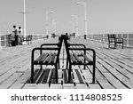 people fishing on the pier ... | Shutterstock . vector #1114808525