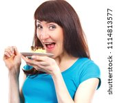 happy delighted woman eating... | Shutterstock . vector #1114813577