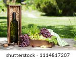 white wine and grape. outdoor... | Shutterstock . vector #1114817207