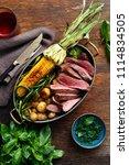 slices beef steak served in... | Shutterstock . vector #1114834505