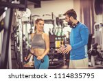 personal trainer provides... | Shutterstock . vector #1114835795