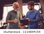 personal trainer giving advice... | Shutterstock . vector #1114849154