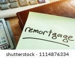 remortgage concept. memo stick  ... | Shutterstock . vector #1114876334