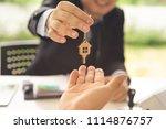 real estate agent or banker... | Shutterstock . vector #1114876757