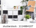 workplace with notebook laptop... | Shutterstock . vector #1114884107