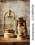 two kerosene lamps on old table ... | Shutterstock . vector #111489434