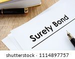 surety bond form and pen on a... | Shutterstock . vector #1114897757