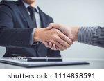 handshake of cooperation... | Shutterstock . vector #1114898591