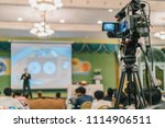 rear side of video cameraman... | Shutterstock . vector #1114906511
