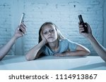 mother and father using mobile... | Shutterstock . vector #1114913867