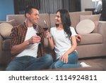 cheers. happy loving couple is... | Shutterstock . vector #1114924811