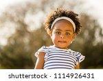 happy african american little... | Shutterstock . vector #1114926431