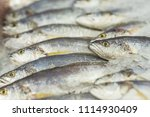 fresh fish on ice in a fish... | Shutterstock . vector #1114930409