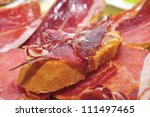 slices of bread with spanish serrano ham served as tapas - stock photo