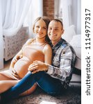 beautiful pregnant woman and...   Shutterstock . vector #1114977317
