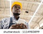 below view of serious... | Shutterstock . vector #1114983899