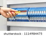 electrician at work inspecting  ... | Shutterstock . vector #1114984475