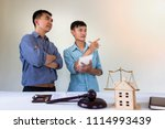 house owner discuss with lawyer ... | Shutterstock . vector #1114993439