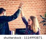 caucasian colleagues give each... | Shutterstock . vector #1114993871