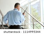 male security guard using... | Shutterstock . vector #1114995344